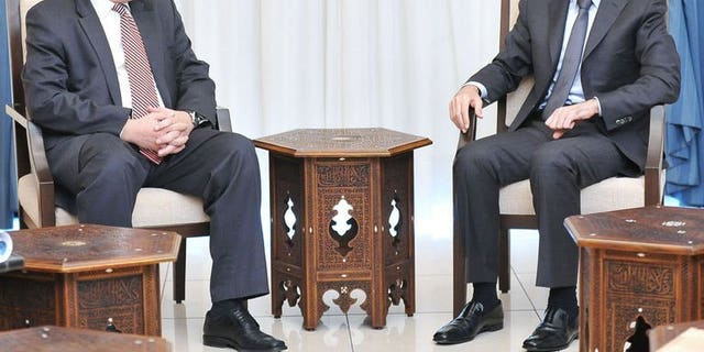 Russian Deputy Foreign Minister Sergei Ryabkov, left, meeting with Syrian President Bashar al-Assad in Damascus.