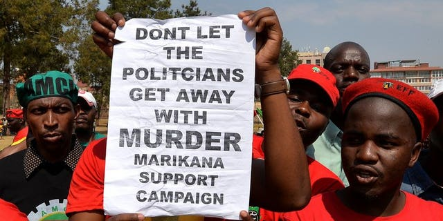 Minners march on South African government buildings in Pretoria on September 12, 2013. A South African commission of inquiry said Thursday that the police lied about the shooting dead of 34 striking miners last year, in a searing criticism of police conduct.