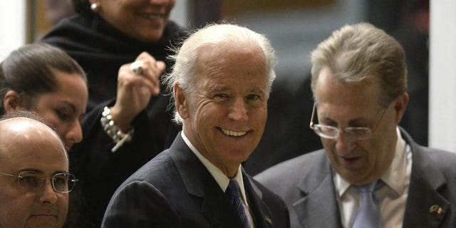 US Vice President Joe Biden (C) arrives at the Benito Juarez international airport in Mexico City, on September 19, 2013 for a one-day official visit.