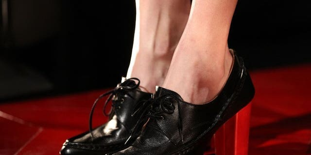 File picture for illustration shows a model wearing shoes on the catwalk at the Leather Japan 2012 Fall 2012 Presentation in New York City on February 13, 2012. A court in Japan Friday jailed a man for slipping corrosive acid into the shoes of a colleague he was stalking, causing her to have the tips of her toes amputated, officials and media reports said.