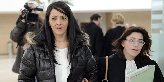 """Bouchra Bagour (L), the mother of a boy named Jihad who was born on September 11, leaves Avignon's courthouse in southern France on December 19, 2012, with her lawyer Gaelle Genoun, after her trial for sending her son to school in a T-shirt with """"I am a bomb"""" written on it."""