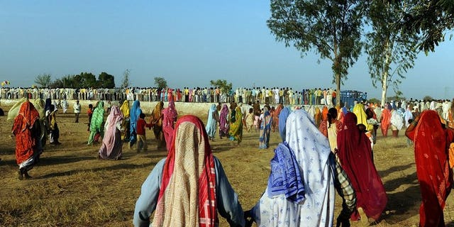 File picture shows people gathering at a public rally at Kondal village in the Palwal district of the Indian state of Haryana on March 1, 2009.