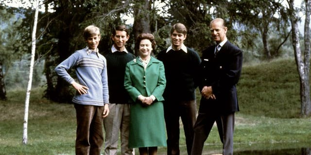 Queen Elizabeth and the Duke of Edinburgh (R) pose with their three sons, Charles, Edward (L), Andrew (2ndR) and the royal corgies in Balmoral Castle, Scotland, November 20, 1979.