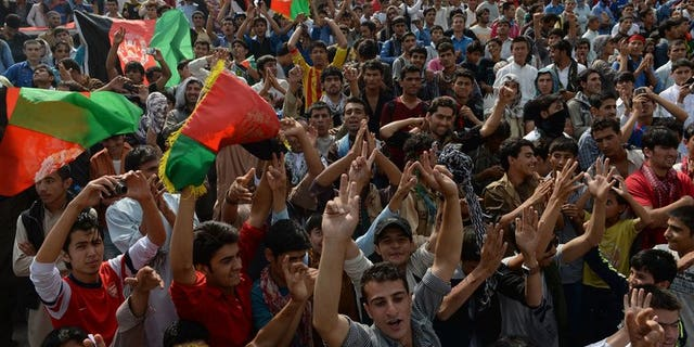 Afghans celebrate their national football team's victory in the South Asian Football Federation Championship, at the Kabul stadium on September 12, 2013. UEFA president Michel Platini is set to visit Afghanistan on Sunday to lend his support to football in the war-torn country, weeks after it claimed its first international trophy.
