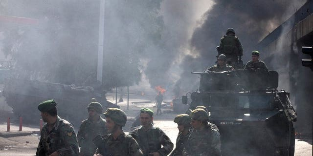 Lebanese soldiers patrol the streets of Beirut, on January 25, 2011. Lebanese troops are to take over security at checkpoints set up by the Hezbollah movement in their southern Beirut stronghold after two bombings, the interior minister has told AFP.