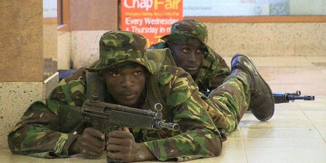 Kenyan troops take position inside the Westgate mall in Nairobi on September 21, 2013. A joint Australian-British architect and his heavily pregnant Dutch wife were named by friends and media as among those killed in the attack.