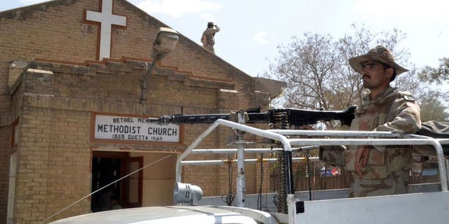 Pakistani soldiers stand guard outside a church in Quetta in Pakistan's restive southwest on September 22, 2013, following two suicide bomb attacks on a church in Peshawar. A bomb targeting police and claimed by the Taliban killed at least five people and wounded five others near Quetta on Monday, police said.