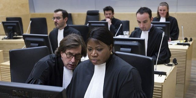 International Criminal Court Prosecutor Fatou Bensouda (right) and senior trial lawyer Eric Mac Donald on February 19, 2013 in The Hague. Bensouda offered Tuesday to help prosecute those behind the deadly attack on Nairobi's Westgate shopping mall, a statement said.