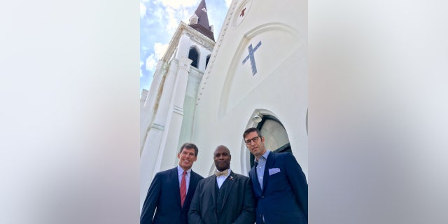 Left to Right: John Darby of The Beach Company, Emanuel AME Church Rev. Eric S.C. Manning, and Michael Arad of Handel Architects in front of Emanuel AME Church in Charleston.