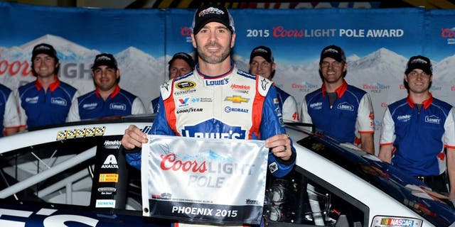 Nov 13, 2015; Avondale, AZ, USA; NASCAR Sprint Cup Series driver Jimmie Johnson poses for a picture after winning the pole for the Quicken Loans Race For Heroes 500 at Phoenix International Raceway. Mandatory Credit: Jasen Vinlove-USA TODAY Sports