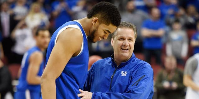 Jan 20, 2015; Lexington, KY, USA; Kentucky Wildcats head coach John Calipari reacts in the huddle with guard Tyler Ulis (3) guard Andrew Harrison (5) and forward Karl-Anthony Towns (12) during the game against the Vanderbilt Commodores in the second half at Rupp Arena. The Kentucky Wildcats defeated the Vanderbilt Commodores 65-57. Mandatory Credit: Mark Zerof-USA TODAY Sports