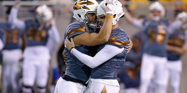Arizona State's Zane Gonzalez, right, gets a hug from holder Matt Haack after Gonzalez connected for a field goal during the second half of an NCAA college football game against UCLA on Saturday, Oct. 8, 2016, in Tempe, Ariz. Gonzalez kicked three field goals to become the NCAA's all-time leader with 89. Arizona State defeated UCLA 23-20. (AP Photo/Ross D. Franklin)