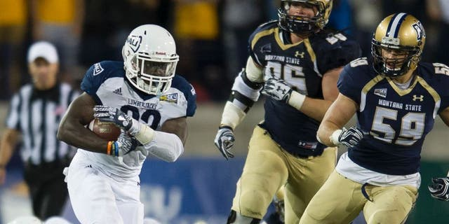 In this photo provided by Montana State University, Northern Arizona running back Joe Logan (22) gains yards during the second half of an NCAA college football game against Northern Arizona on Saturday, Oct. 8, 2016 in Bozeman, Mont. Northern Arizona won 20-14. (Kelly Gorham/Montana State University via AP)