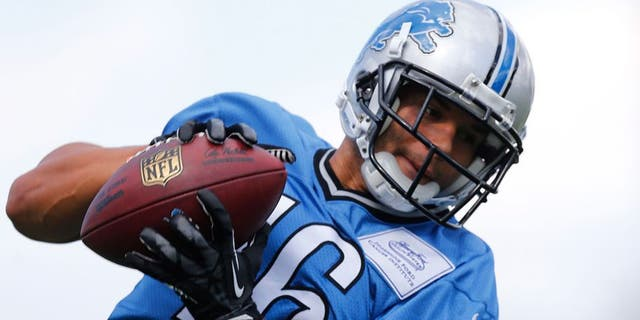 Detroit Lions wide receiver Lance Moore catches a pass during NFL football training camp in Allen Park, Mich., Monday, Aug. 3, 2015. (AP Photo/Paul Sancya)