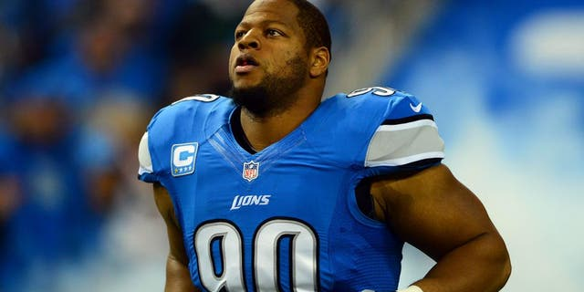 Oct 27, 2013; Detroit, MI, USA; Detroit Lions defensive tackle Ndamukong Suh (90) during player introductions prior to the game against the Dallas Cowboys at Ford Field. Mandatory Credit: Andrew Weber-USA TODAY Sports