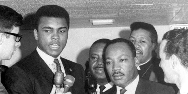 In this March 29, 1967, file photo, heavyweight champion Muhammad Ali, center left, and Dr. Martin Luther King speak to reporters. Ali, the magnificent heavyweight champion whose fast fists and irrepressible personality transcended sports and captivated the world, has died according to a statement released by his family Friday, June 3, 2016. He was 74.