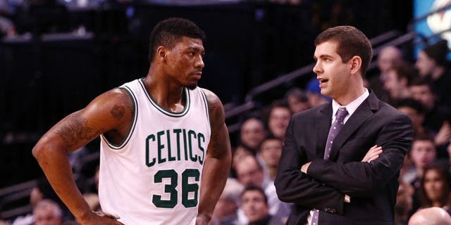 Jan 30, 2015; Boston, MA, USA; Boston Celtics head coach Brad Stevens (right) speaks to guard Marcus Smart (36) during the second half of a game against the Houston Rockets at TD Garden. Mandatory Credit: Mark L. Baer-USA TODAY Sports