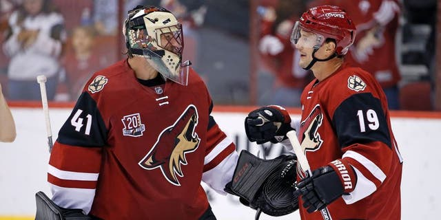 Arizona Coyotes' Mike Smith (41) and Shane Doan (19) celebrate the Coyotes' 3-1 win over the San Jose Sharks in an NHL preseason hockey game Friday, Oct. 7, 2016, in Glendale, Ariz. (AP Photo/Ross D. Franklin)