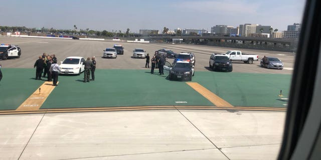 The unidentified man was spotted by Los Angeles International Airport police just after 1:30 p.m. local time.