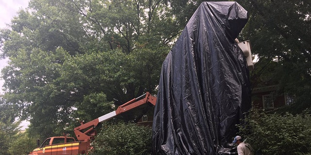 A statue of Confederate Gen. Stonewall Jackson is covered with a black shroud in Charlottesville, Va. Wednesday