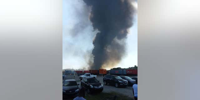 A plume of black smoke was seen billowing from the scene after a National Guard cargo plane crashed in Savannah, Georgia.