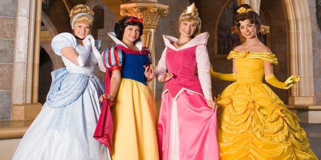 Disney princesses Cinderella, Snow White, Aurora and Belle share a royal moment at Disneyland in Anaheim, Calif.