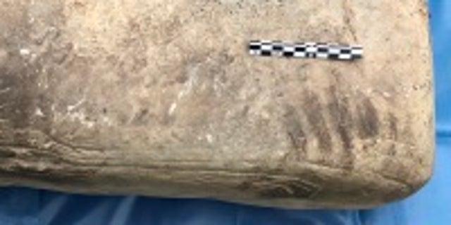 The ancient stone anvil (University of Bradford/Swandro-Orkney Coastal Archaeology Trust)