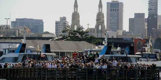Spectators crowd Pier 39 in San Francisco to watch the 2013 America's Cup sailing event.