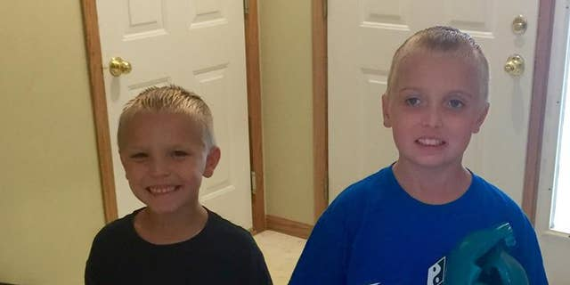 Gavin,9, and his brother Gage, 6, in June 2015.