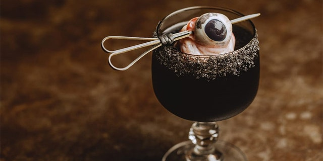 A new Australian restaurant is shocking customers with a Black Margarita, accented with feral pig eye and black salt rim.