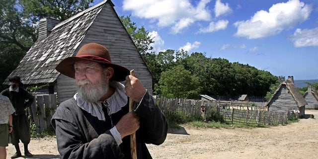 FILE - This June 27, 2006, file photo, shows a 17th century costumed role player, who called himself Samuel Fuller, in a 1627 Pilgrim Village at Plimoth Plantation in Plymouth, Mass. Leading scholars from around the globe are teaming up to shed more light on how America got its start. Prominent museums and historical societies from the U.S. and Europe that specialize in the 17th century have formed New England Beginnings. The group said it's also trying to dispel myths about how the settlers interacted with Native Americans. (AP Photo/Chitose Suzuki, File)