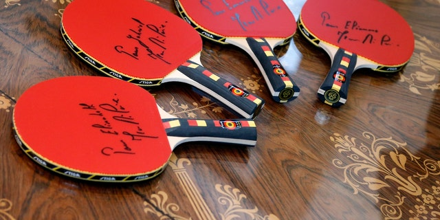 File photo - A set of bats offered to the children of King Philippe by former Belgian table tennis champion Jean-Michel Saive are pictured at Brussels' Royal Palace, Belgium, Jan. 5, 2016. (REUTERS/Francois Lenoir)