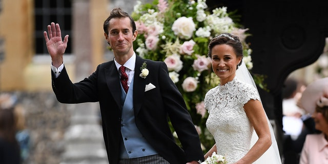 Pippa Middleton and her husband, James Matthews, smile following their wedding ceremony at St Mark's Church in Englefield, west of London, on May 20, 2017.