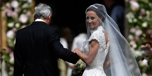 Pippa Middleton is escorted by her father Micheal Middleton as she arrives for her wedding.