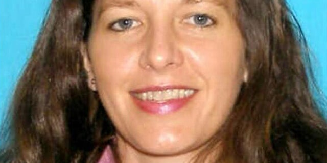 March 8, 2013: This undated image released by the Seattle police shows 46-year-old Carolyn Piksa, who authorities say is suspected of critically wounding a 65-year-old man in a Seattle parks department building. She was arrested at her home Friday, hours after fleeing the scene of the shooting. (AP/Seattle Police)