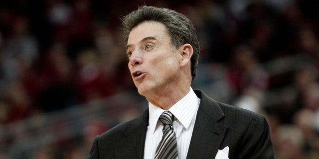 Dec. 18: Louisville coach Rick Pitino gives instructions to his team in their NCAA college basketball game against Gardner-Webb in Louisville, Ky. (AP)
