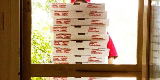 """""""It's so irritating, I don't even get my work done anymore,"""" the lawyer says of the unwanted pizza deliveries."""