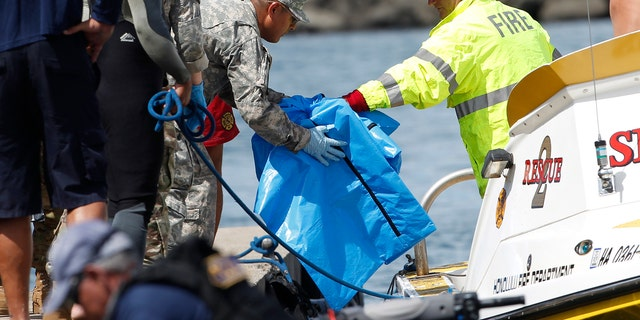 An Army helicopter with five on board crashed several miles off Oahu's North Shore late Tuesday. Rescue crews are searching the waters early Wednesday.