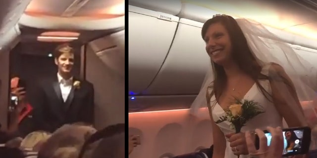 In a video shot by a fellow passenger, the couple is seen standing at opposite ends of the aisle as music starts playing.
