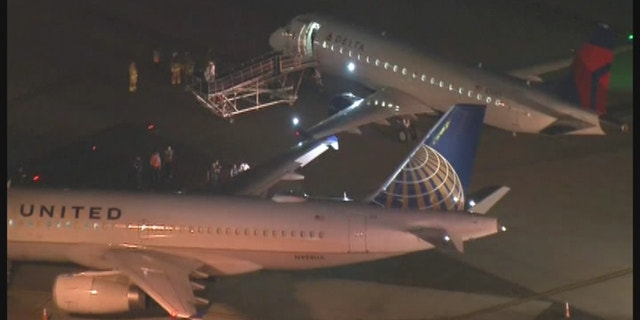The Delta aircraft was taxiing to the gate when it struck the wing of the empty United plane.