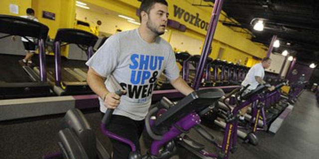 """FILE: Nathan Montgomery, a contestant from the television show """"The Biggest Loser"""" works out at a Planet Fitness in Colorado Springs, Colo."""