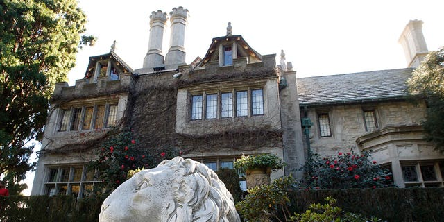 "Designed by Arthur R. Kelly, the mansion has been described as being an example of ""Gothic-Tudor"" style."