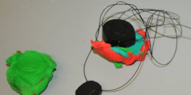 The Play-Doh was used to attempt to cover a security device.