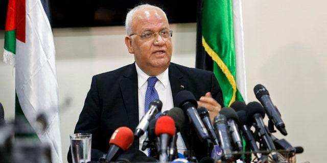 Saeb Erekat speaks to reporters in Ramallah Wednesday.