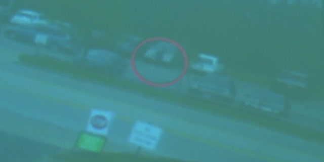 Kyle Plush is seen in surveillance video getting into his minivan on April 10, the day he was crushed in the backseat.