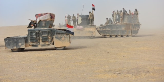PMF fighters work alongside Iraqi Forces, prompting concern they may access U.S-issued equipment.