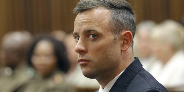 Oscar Pistorius looked downward as Steenkamp testified.