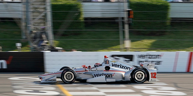 Will Power crosses the finish line to win the IndyCar auto race at Pocono Raceway, Sunday, Aug. 20, 2017, in Long Pond, Pa. (AP Photo/Matt Slocum)