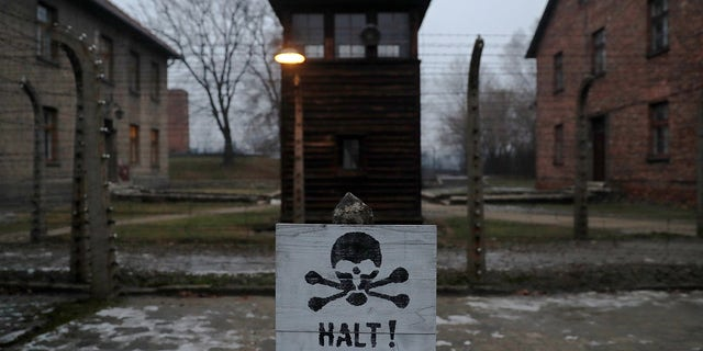 """A sign reading """"Stop!"""" in German and Polish is seen at the former Nazi German concentration and extermination camp Auschwitz."""
