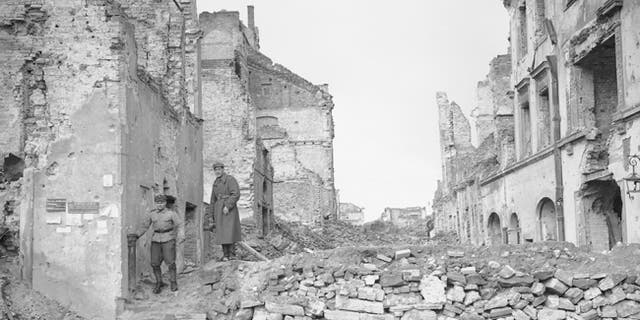 Two German soldiers make their way through the gutted city of Warsaw, Poland's capital, in September 1945.